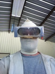 Suited up, ready to apply an elastomeric coating to the INSIDE of a building.