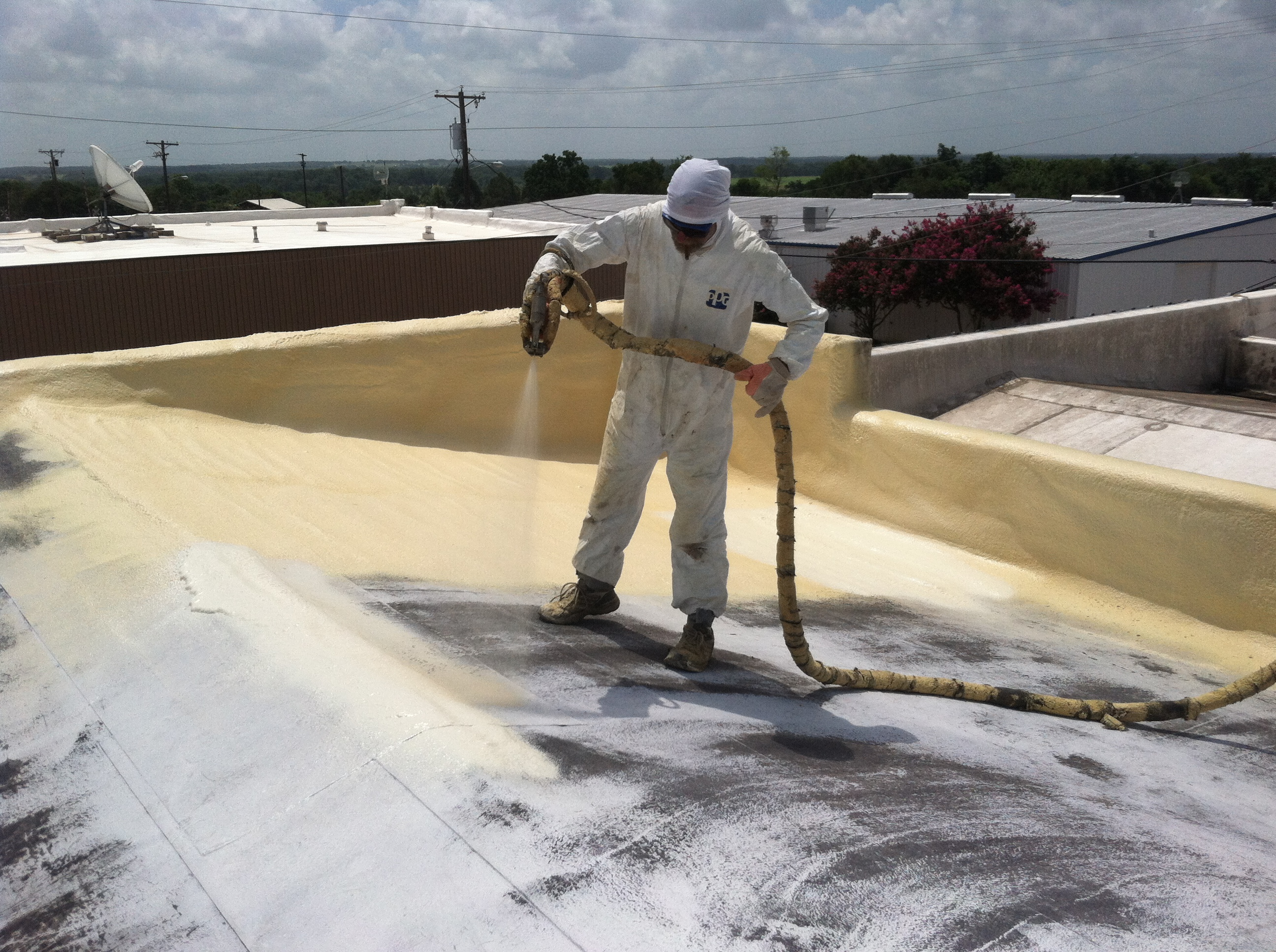 Spray Polyurethane Foam being applied to a roof. Not only does this provide an insulation & Spray Foam Roofing System | J L Cox Enterprises - 512-415-0032 memphite.com